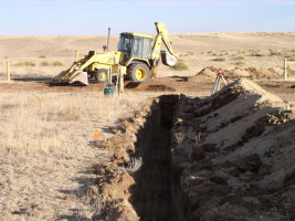 Picture of backhoe moving earth