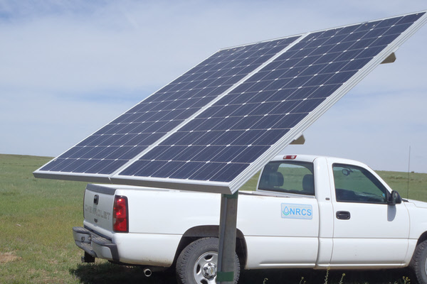 Picture of NRCS and installed solar panels for pumping system.