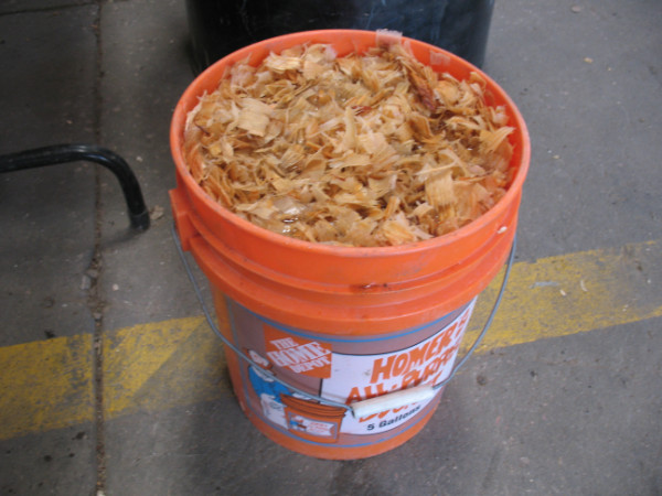 Soaking woodchips for packing material.