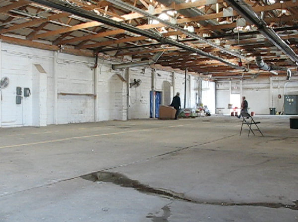 Picture of empty warehouse space to be filled by 15,000 seedling trees